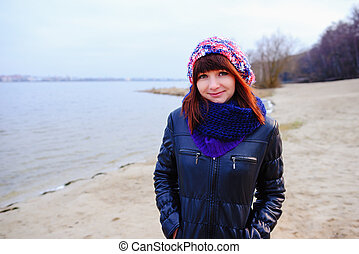 Autumn pretty girl posing near mountain lake. autumn lanscape in forest.