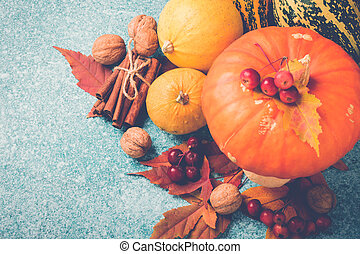 Autumn pumpkin Thanksgiving composition with leaves and nuts. Top view