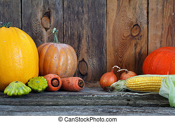 Autumn pumpkins and other vegetables on a wooden thanksgiving table, selective focus