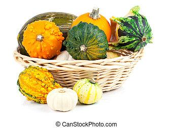 Autumn pumpkins in a straw basket