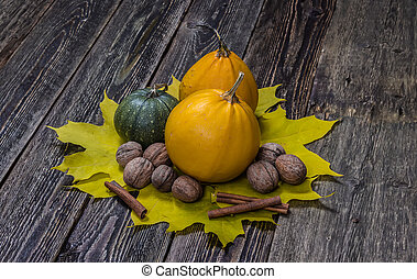 Autumn pumpkins with fall leaves