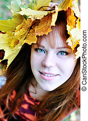 autumn redheaded gril with crown from leaves
