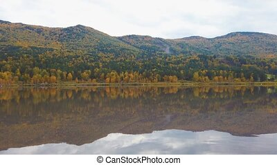 Autumn reflections of the Manjerokskoe lake, Altai Republic, Russia