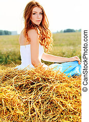 autumn - Romantic young woman posing outdoor.