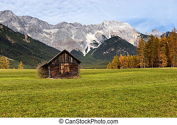 Autumn rural scenery of Miemenger Plateau with rocky mountains peaks in the background. Austria, Europe, Tyrol.