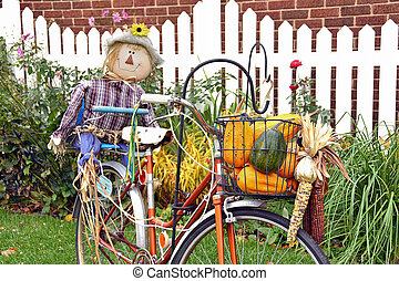 scarecrow on bicycle