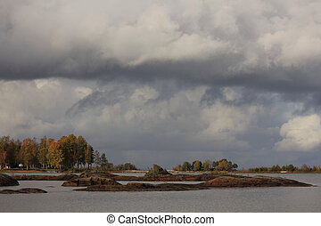 Autumn scene in Vita Sannar. Moody sky over the shore of ...