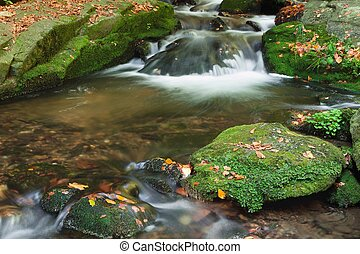 Autumn scene with cascading waterfall