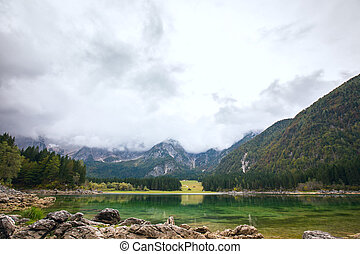 Autumn scenery at lake Fusine mountain lake - Autumn scenery...