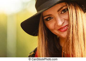 Portrait of attractive woman.