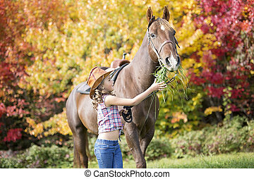 Autumn season young girl and horse - in a beautiful Autumn...