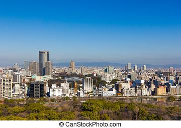 Autumn skyline of Osaka, Japan viewed from Osaka Castle Park.