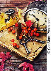 autumn still life - Od clock book and the keys on the wet...