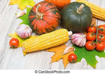autumn still life of vegetables and autumn maple leaves -...