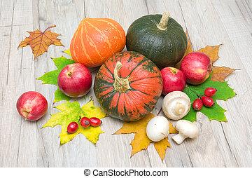 autumn still life. pumpkin, berries, mushrooms and red apples