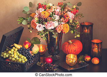 Autumn still life with flowers, pumpkin, fruits and candles....