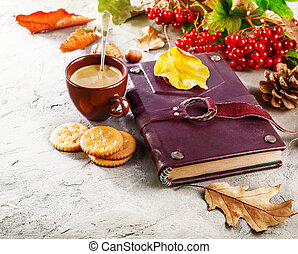 Autumn still life with cup coffee book