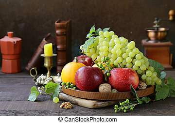 autumn still life with fruits and pumpkins