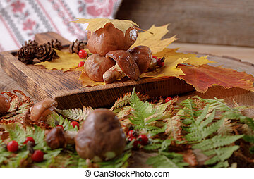 Autumn still life with mushrooms and leaves.
