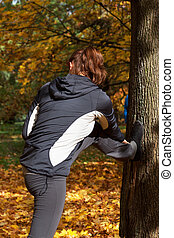 Autumn stretching in park