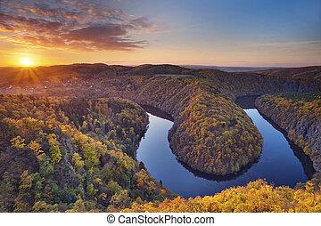 Beautiful meander of Vltava river in Czech Republic during autumn sunset.