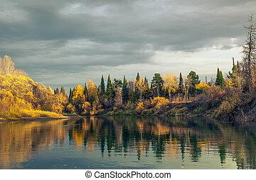 Autumn Sunset in the wild Siberian taiga