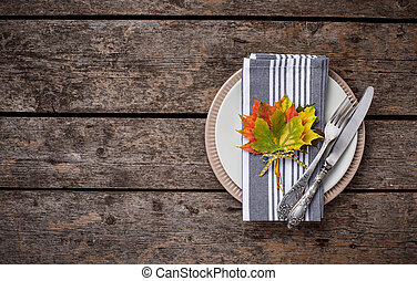 Autumn table setting with colorful leaves