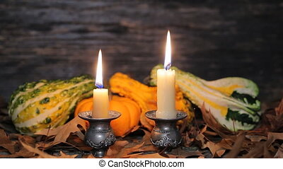 Autumn table setting with pumpkins and candles, fall home...