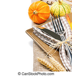 Autumn table setting with pumpkins isolated over white