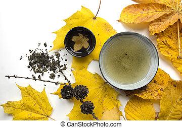 Autumn tea time still life closup on white background