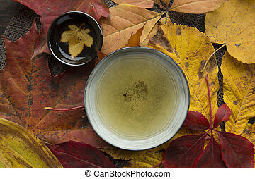 Autumn tea time still life top view closup