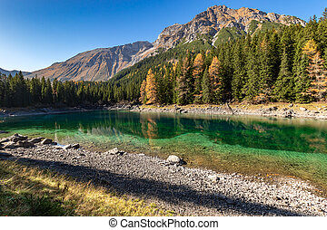 Autumn time at romantic forest Lake Obernberg one of the best known mountain lakes in Austria, Tyrol.