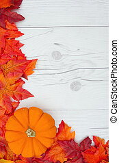 Autumn Time Background, Some fall leaves and a pumpkin on weathered wood with copy space for your message