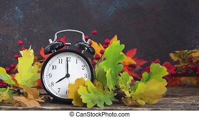 Autumn time - fall leaves with clock