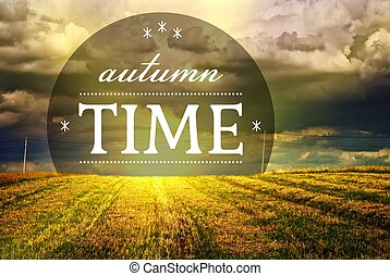 Autumn time with grass field landscape and sunset