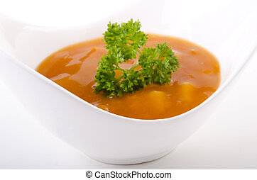 autumn vegetable soup in a white bowl