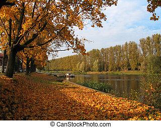 autumn view at the river in tartu, estonia