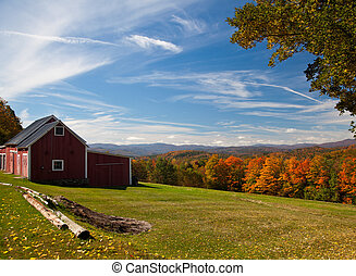 Autumn view in Vermont - Fall leaves add color to a bright ...