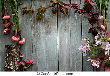 abstract blue wood vintage background with ivy and pink flowers