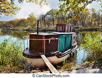 Autumn, water, landscape. Small ship