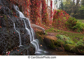 Autumn waterfall in the park