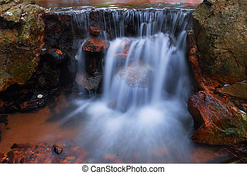 Autumn waterfall is beautiful