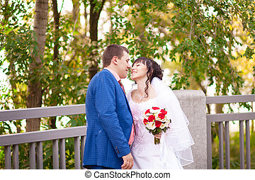 Autumn wedding bride and groom