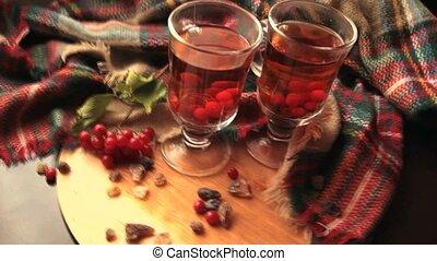 Autumn winter viburnum Tea In A Transparent Glass Mug, Berries Of A Guelder-rose