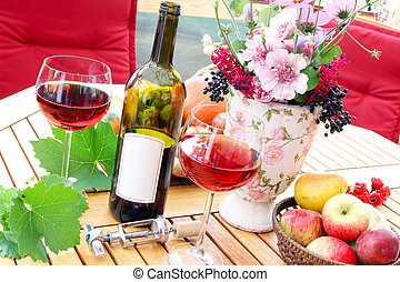 Autumn with red wine on the terrace
