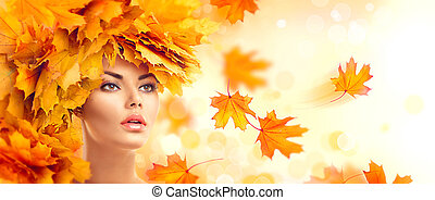 Autumn woman. Fall. Beauty model girl with autumn bright leaves hairstyle
