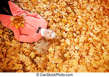 Autumn woman on background fall landscape leaves of trees