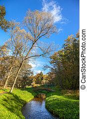 Autumn wood bridge over creek in Polczyn Zdroj, Poland.