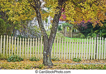 A colorful Autumn yard surrounded by a picket fence in Clinton New Jersey.