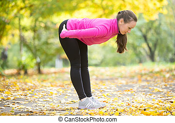 Autumn Yoga outdoors: Standing half forward bend pose